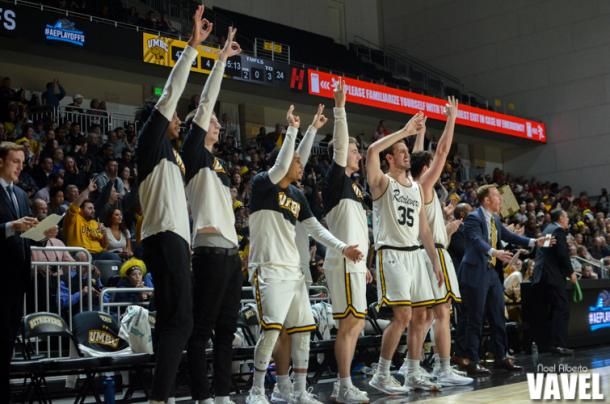 The UMBC bench reacts to a huge three