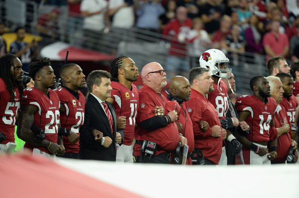 The Arizona Cardinals link arms during the National Anthem before the start of the NFL game against the Dallas Cowboys (Sept. 24, 2017 - Source: Jennifer Stewart/Getty Images North America)