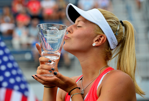 Dalma Galfi kisses the winner's trophy after winning the girls' singles titles at the 2015 U.S. Open Junior Tennis Championships. | Photo: Alex Goodlett/Getty Images