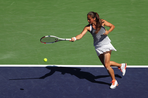Kasatkina strikes a forehand. Photo: Julian Finney/Getty Images