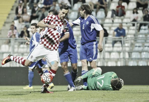 Above: Nikola Kalinic striking home in Croatia's 10-0 win over San Marino | Photo: AP Photo/Darko Bandic