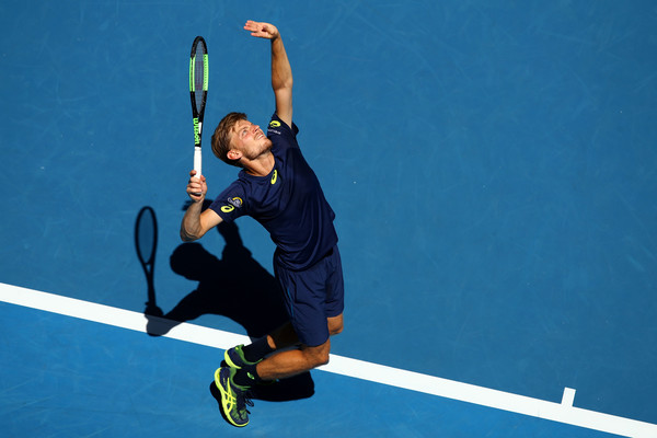 David Goffin hits a serve during his fourth-round match against Ivo Karlovic at the 2017 Australian Open. | Photo: Cameron Spencer/Getty Images