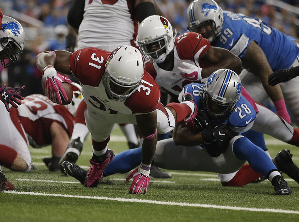 David Johnson (31) gets into the end zone against the Detroit Lions. |Source: Gregory Shamus/Getty Images North America|