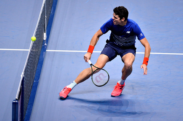 Raonic watches the ball drift over the net (Photo by Justin Setterfield/Getty Images)