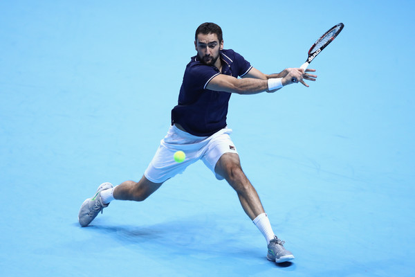 Cilic reaches for the ball (Photo by Julian Finney/Getty Images)