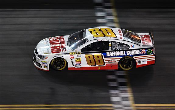 Dale Earnhardt Jr. crosses the finish line to win the 2014 Daytona 500. (Jared C. Tilton/NASCAR via Getty Images)