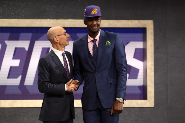 Deandre Ayton poses with Commissioner Adam Silver after being drafted first overall by the Phoenix Suns. |Source: Mike Stobe/Getty Images North America|