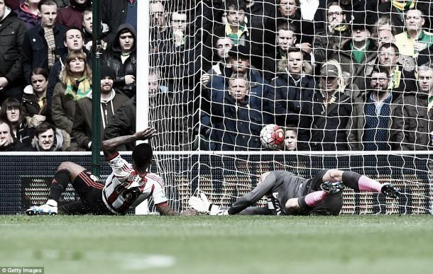 Above: Jermain Defoe pokes home Sunderland AFC's second goal in their 3-0 win over Norwich City | Getty Images