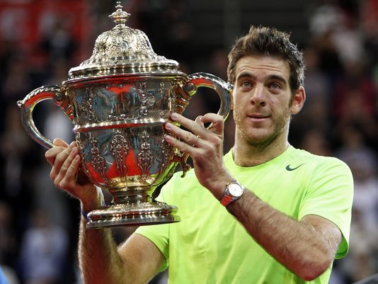 Juan Martin del Potro hoists his 2012 Basel trophy. Photo: Urs Flueeler/AP