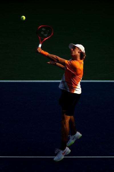 Denis Shapovalov hits a backhand volley during his first-round match against Félix Auger-Aliassime at the 2018 U.S. Open.   Photo: Julian Finney/Getty Images