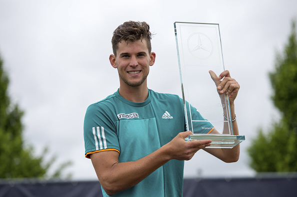 Dominic Thiem poses with the title after winning the Mercedes Cup in Stuttgart (Getty/Deniz Calagan)