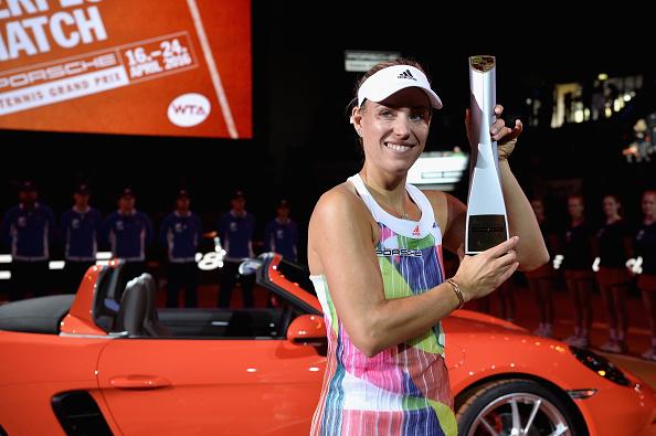 Kerber with the title at the Porsche Tennis Grand Prix, after beating Laura Siegemund in the final (Getty/Dennis Grombkowski)