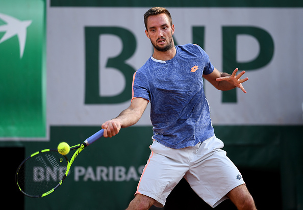 Troicki keeps his eye on the ball as he rips the forehand for a winner. Credit: Dennis Grombkowski/Getty Images