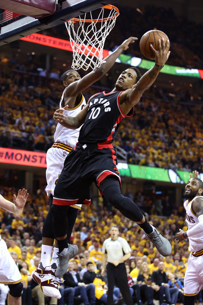 DeRozan contested at the rim by Tristan Thompson. Credit: Andy Lyons/Getty Images North America