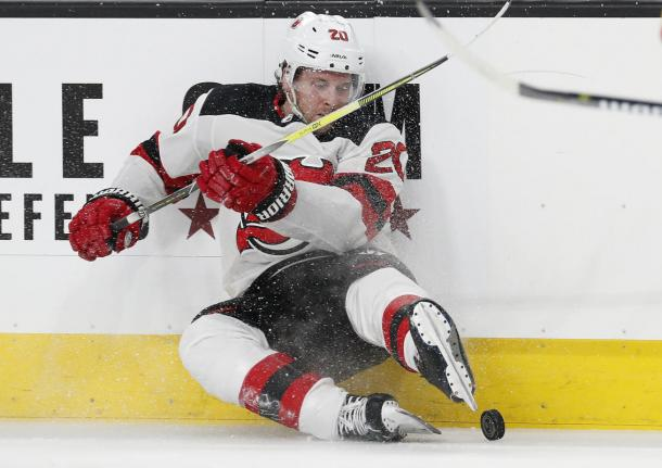 The New Jersey Devils kicked their way past the Vegas Golden Knights in a romp 8-3. (AP Photo/John Locher)