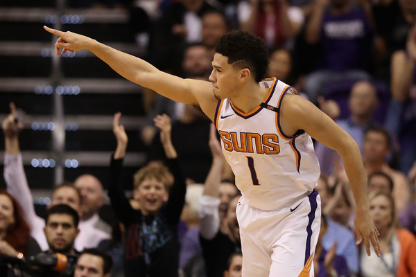 Devin Booker #1 of the Phoenix Suns reacts after hitting a three point shot against the Los Angeles Lakers. |Nov. 12, 2017 - Source: Christian Petersen/Getty Images North America|