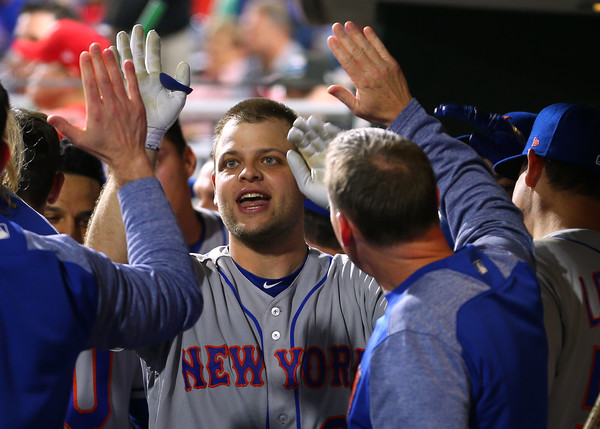 Mesoraco receives congratulations in the New York dugout after his ninth-inning home run/Photo: RIch Schultz/Getty Images