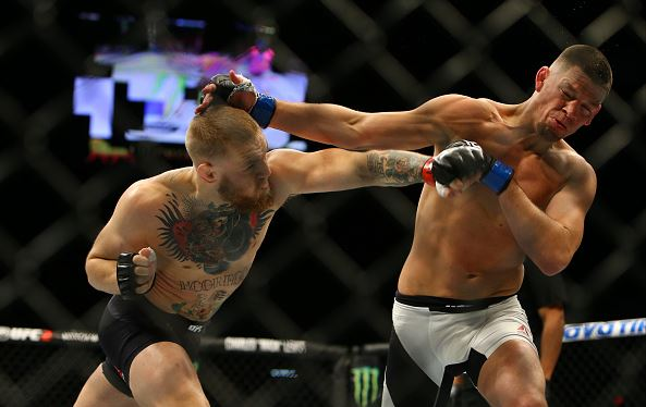 Conor McGregor punches Nate Diaz during UFC 196 at the MGM Grand Garden Arena on March 5, 2016 in Las Vegas, Nevada. (Photo by Rey Del Rio/Getty Images