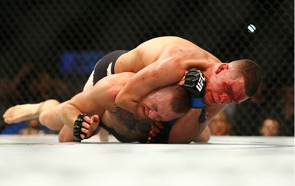 Nate Diaz applies a choke hold to win by submission against Conor McGregor during UFC 196 at the MGM Grand Garden Arena on March 5, 2016 in Las Vegas, Nevada. (Photo by Rey Del Rio/Getty Images