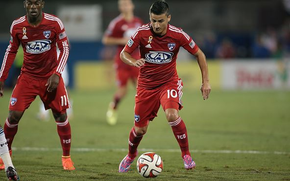 Mauro Diaz (right) of FC Dallas handles the ball against Vancouver FC at Toyota Stadium in Frisco on September 14, 2014 in Frisco Texas / Rick Yeatts - Getty Images)