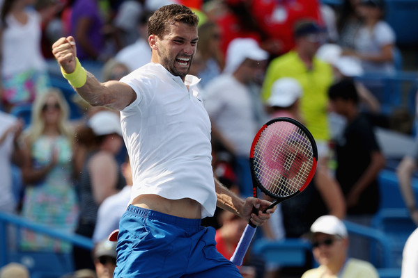 Dimitrov reacts to clinching his place in the final. Photo: Rob Carr/Getty Images