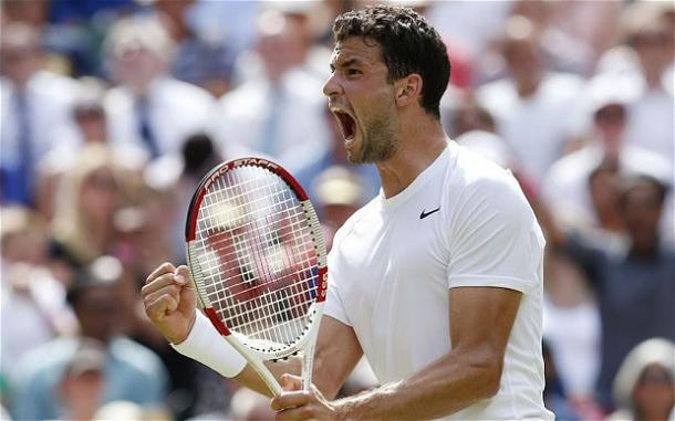 Dimitrov celebrates his win over Murray at Wimbledon in 2014. Photo: PA