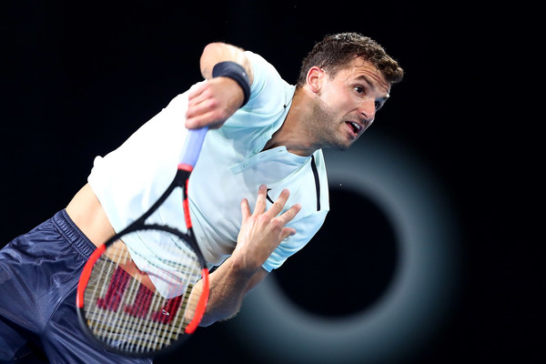 Grigor Dimitrov serves in his quarterfinal win. Photo: Chris Hyde/Getty Images
