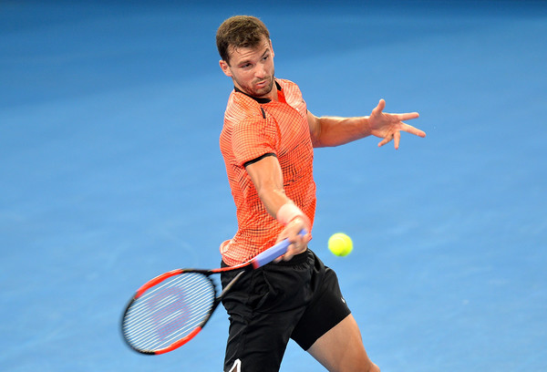 Grigor Dimitrov hits a forehand during his match with Dominic Thiem. Photo: Bradley Kanaris/Getty Images