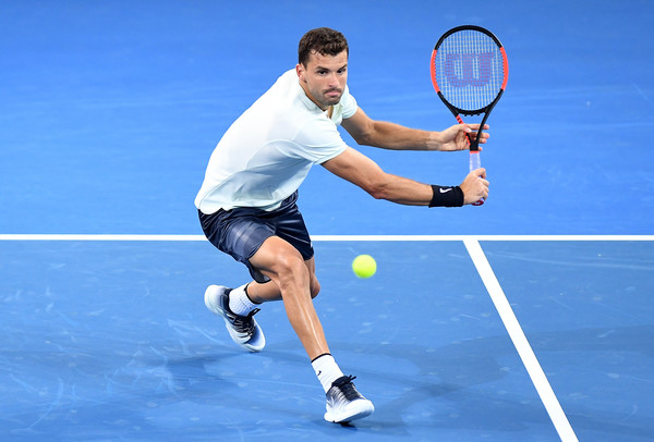 Dimitrov lines up a backhand volley during his season debut in Brisbane. Photo: Bradley Kanaris/Getty Images