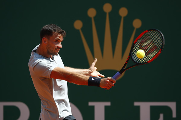 Grigor Dimitrov stretches for a backhand during his semifinal loss. He just could not hang with Nadal after a tough first set. Photo: Julian Finney/Getty Images