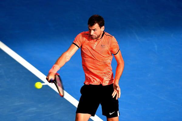 Dimitrov hits a backhand. Photo: Bradley Kanaris/Getty Images