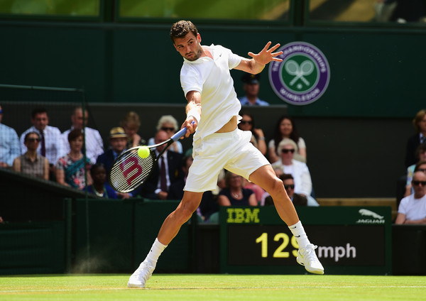 Dimitrov hits a forehand at Wimbledon in 2015. Photo: Shaun Botterill/Getty Images