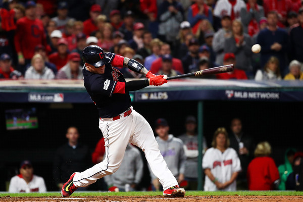 Roberto Perez #55 of the Cleveland Indians hits an RBI single scoring Austin Jackson #26 in the fifth inning against the New York Yankees in Game Five of the American League Divisional Series. |Oct. 11, 2017 - Source: Gregory Shamus/Getty Images North America|