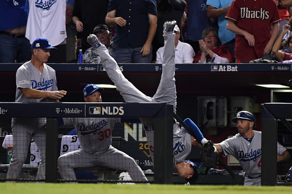 Cody Bellinger #35 of the Los Angeles Dodgers tumbles into the dugout after catching a foul ball during the fifth inning of the National League Divisional Series. |Source: Norm Hall/Getty Images North America|