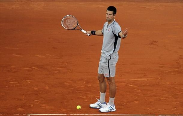 Novak Djokovic shows his frustration during his 2013 loss in Madrid. Photo: AP