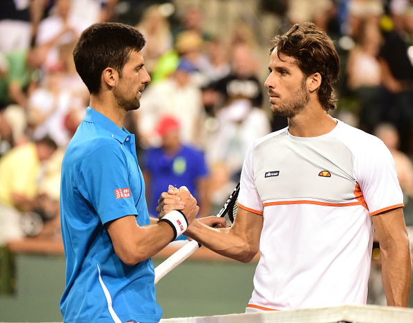 Djokovic (left) and Feliciano Lopez shake hands after their match. Photo: Harry How/Getty Images