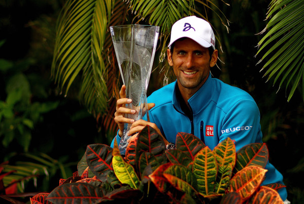 Djokovic poses with his Miami trophy after winning in 2016. Photo: Mike Ehrmann/Getty Images