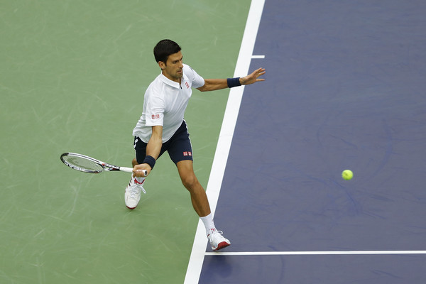Djokovic chases down a forehand during his third round match. Photo: Lintao Zhang/Getty Images