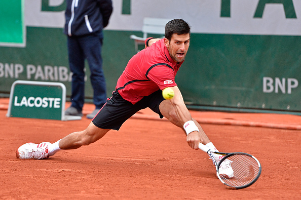Djokovic slides into a backhand during his victory. Photo: Aurelien Meunier/Getty Images