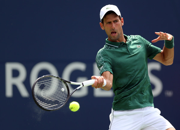 Novak Djokovic crushes a forehand during his wild ride on Tuesday in Toronto. Photo: Getty Images