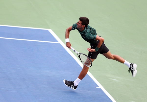 Novak Djokovic serves during his victory over Polansky. Photo: Getty Images