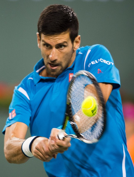 Novak Djokovic hits a backhand during his win on Tuesday. Photo: Robyn Beck/AFP/Getty Images