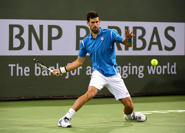Djokovic hits a forehand during his fourth round match. Photo: Harry How/Getty Images