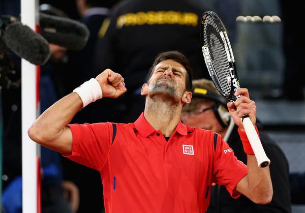 Novak Djokovic celebrates his semifinal win over Nishikori. Photo: Clive Brunskill/Getty Images