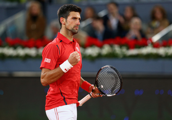 Novak Djokovic pumps his fist during his semifinal win. Photo: Clive Brunskill/Getty Images