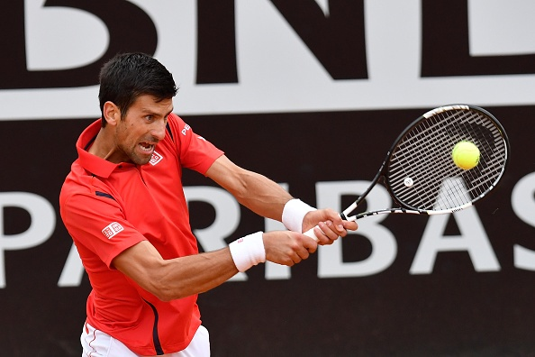Djokovic hits a backhand during his semifinal. Photo: Claudio Pasquazi /Anadolu Agency/Getty Images