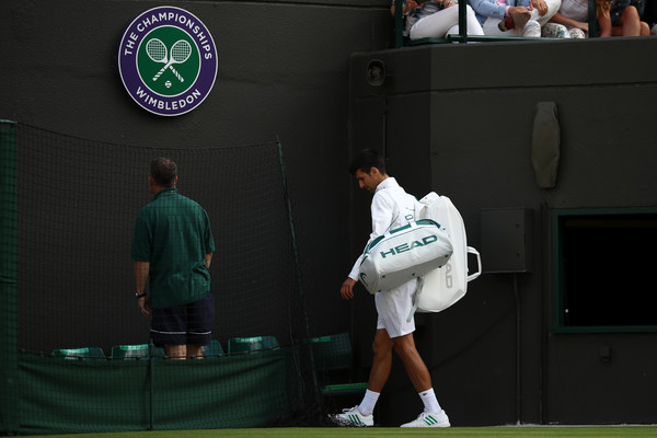 Djokovic walks off the court at Wimbledon following his injury retirement at Wimbledon. Photo: Julian Finney/Getty Images