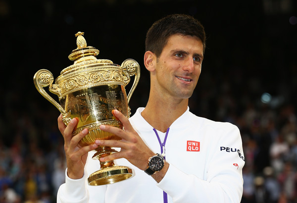 Novak Djokovic hoists his Wimbledon trophy in 2015, his last victory at the All England Club. Photo: Clive Brunskill/Getty Images