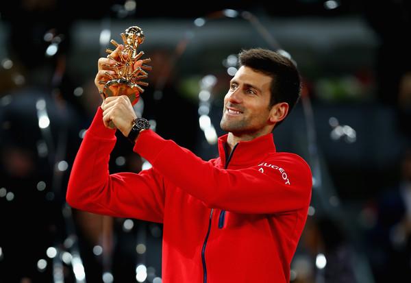 Novak Djokovic hoists the trophy after winning in Madrid. Photo: Clive Brunskill/Getty Images