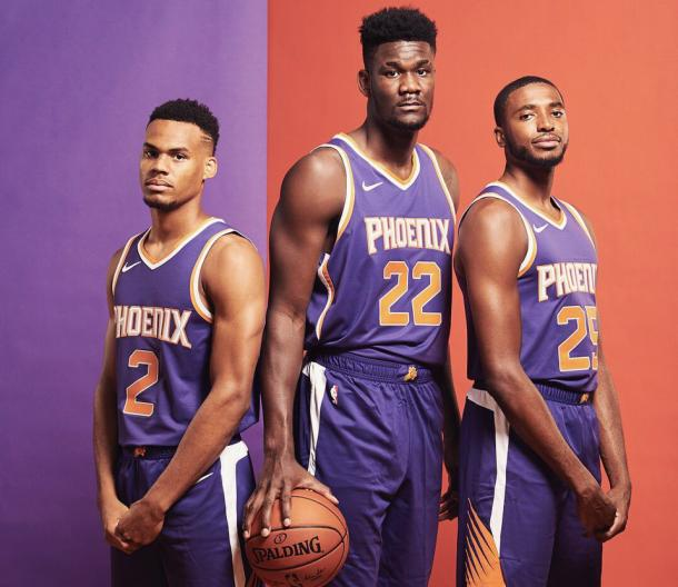 Mikal Bridges #25 and Elie Okobo #2 and DeAndre Ayton of the Phoenix Suns |Jennifer Pottheiser/NBAE via Getty Images|